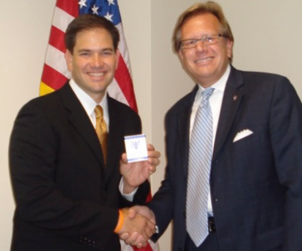 founder shaking hands with Marco Rubio
